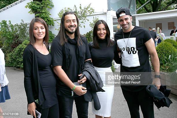 Moundir his wife Ines Milan AC French Football player Adil Rami and his companion Sidonie attend the 2015 Roland Garros French Tennis Open Day 2 on...