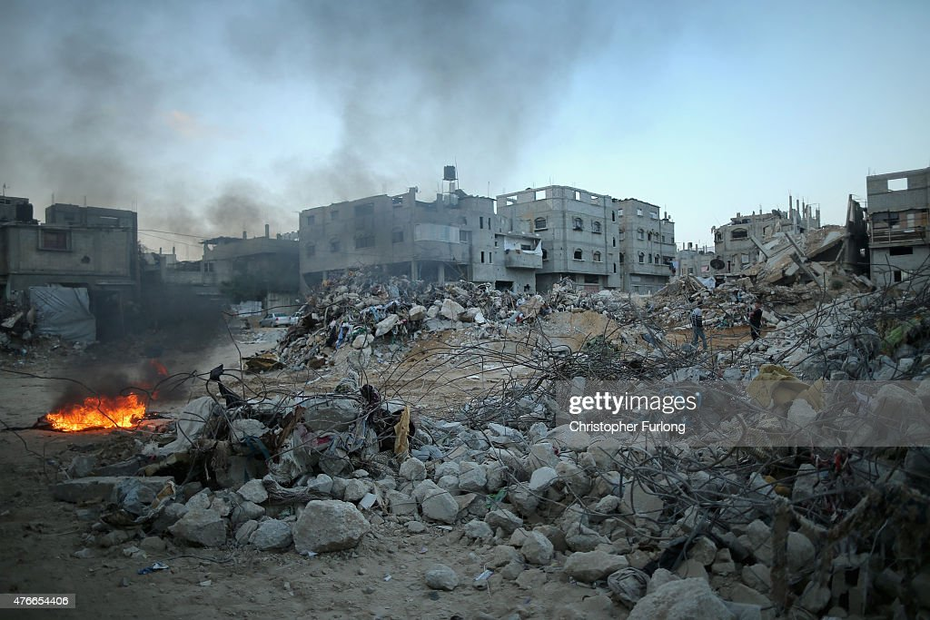 Mounds of rubble and destroyed buildings continue to scar the landscape of Gaza on June 10 Gaza City Gaza The devastation across Gaza can still be...