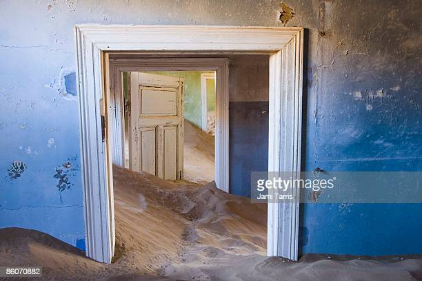 Mounds of sand in abandoned house
