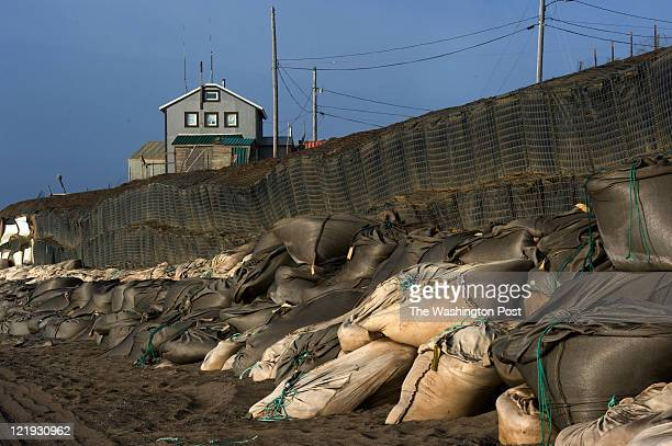 Mounds of sandbags protect the shoreline in Wainwright Alaska on July 18 2011 Several houses in the community have been moved because of erosion...