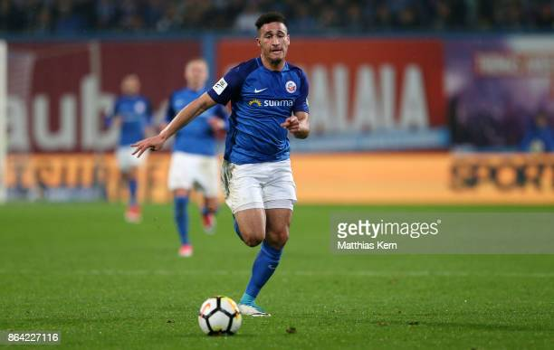 Mounir Bouziane of Rostock runs with the ball during the third league match between FC Hansa Rostock and VfL Osnabrueck at Ostseestadion on October...