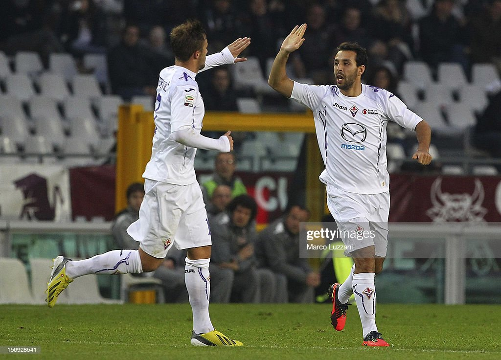 Mounir El Hamdaoui (R) of ACF Fiorentina celebrates his goal with team-mate Haris Seferovic (L) during the Serie A match between Torino FC and ACF Fiorentina at Stadio Olimpico di Torino on November 25, 2012 in Turin, Italy.