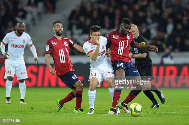 Mounir Obbadi of Lille and Guido Carrillo of Monaco and Ibrahim Amadou of Lille during the French League 1 match between Lille OSC and AS Monaco on...