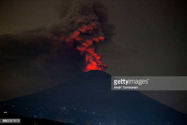 KARANGASEM BALI INDONESIA NOVEMBER 27 Mount Agung spews volcanic ash into the sky at night on November 27 2017 in Karangasem Island of Bali Indonesia...