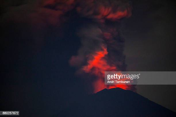 KARANGASEM BALI INDONESIA NOVEMBER 27 Mount Agung spews volcanic ash into the sky at night on November 27 2017 in Karangasem Island of Bali Indonesia...