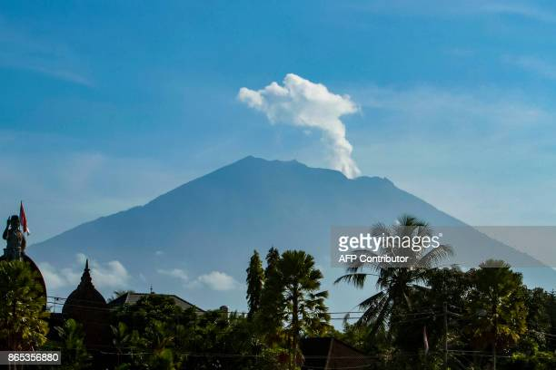 Mount Agung volcano spews steam and smoke into the air as seen from Bangli on Indonesia's resort island of Bali on October 23 2017 Thousands of...
