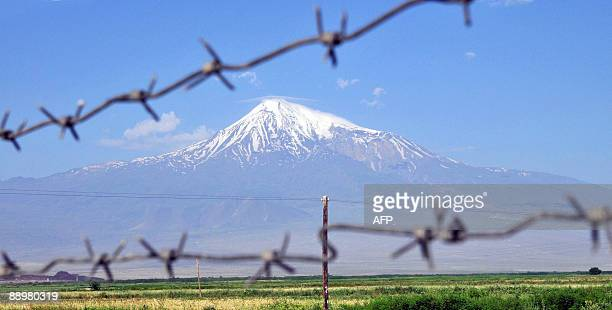 Mount Ararat is seen through a barbedwire fence from the Armenian town Artashat on July 11 2009 Tantalisingly close and cruelly distant Armenia's...