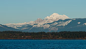 Winter view of Mount Baker with Padilla Bay in the foreground.