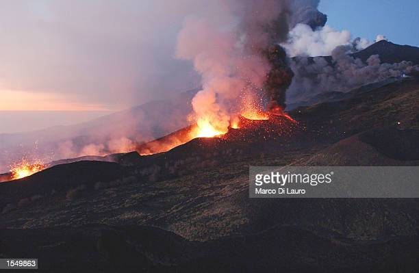 Mount Etna Europe's most active volcano explodes spilling lava down the mountain sides and shooting ash into the sky October 30 2002 near the town of...