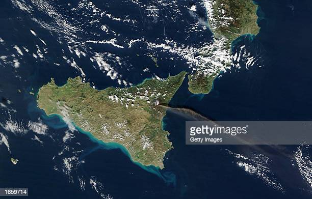 Mount Etna spews a brown streak of ash and smoke on November 23 2002 on Sicily Italy After the volcano's eruptions had been tapering off in the past...