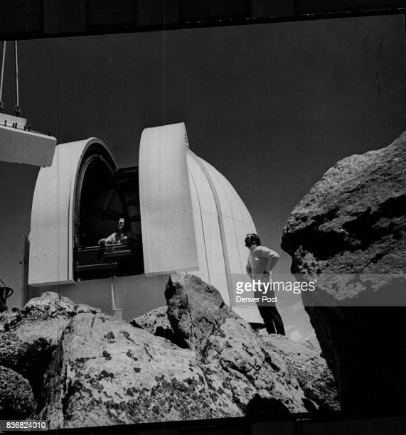Mount Evans Tony Carruthers right chief production engineer for EalingBeck Watford England supervises the installation of the observatory's telescope...