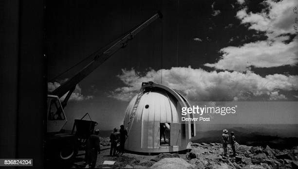 Mount Evans Workmen and scientists unload and assemble the University of Denver's 24inch EalingBeck reflecting telescope near the summit of Mt Evans...