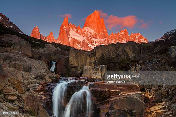 Mount Fitz Roy at sunrise with waterfall
