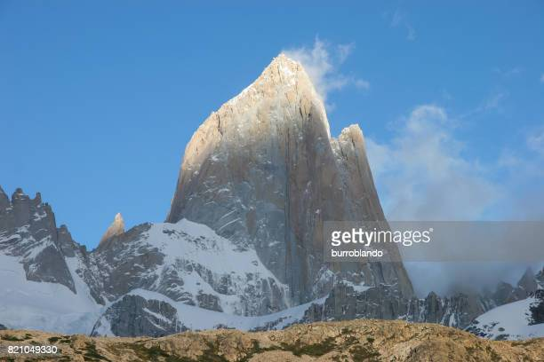 Mount Fitz Roy shines magnificently in the bright morning sun in the patagonian andes in Argentinian Patagonia, South America