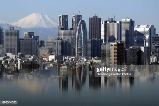Mount Fuji and buildings in the Shinjuku district are reflected