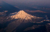 Mount Hood a dormant volcano located east of Portland is viewed from a southbound Alaska Airlines commercial flight on November 28 near Portland...