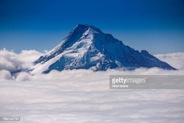 Mount Hood summit through the clouds, Oregon, America, USA