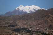 Mount Illimani looms over the city of La Paz Bolivia on Monday July 8 2013 Central bank President Marcelo Zabalaga sees inflation accelerating to 48%...