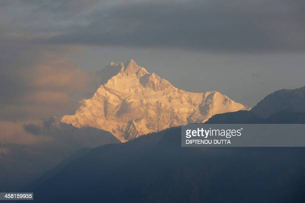 Mount Kangchenjunga is seen from Pelling in India's Sikkim state on December 19 2013 Kangchenjunga is the world's third highest mountain at 8586...