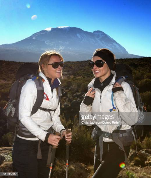 Mount Kilimanjaro rises in the background as Cheryl Cole and Kimberley Walsh set out from camp early in the morning on the third day of The BT Red...