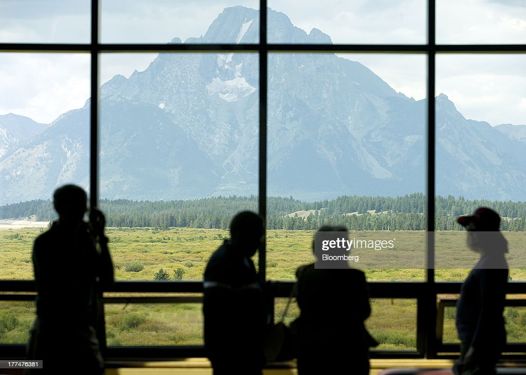 Mount Moran in Grand Teton National Park is seen through a window at the Jackson Hole economic symposium, sponsored by the Kansas City Federal Reserve Bank at the Jackson Lake Lodge in Moran, Wyoming, U.S., on Friday, Aug. 23, 2013. The U.S. central banks bond buying is a less potent tool for stimulating growth than policy makers believe, two economists said in a paper released today at a Federal Reserve conference. Photographer: Price Chambers/Bloomberg via Getty Images