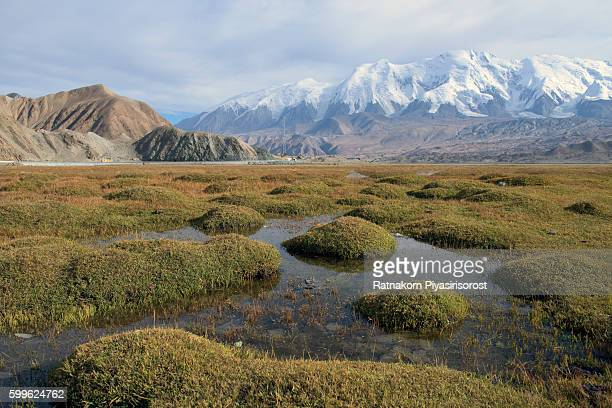 Mount Muztag Ata, the father of ice mountains, and the Karakul Lake, on the Pamirs Plateau, Taxkorgan, Kashgar, Xinjiang, China