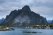 Mount Olstind and Reine fishing village on Lofoten islands in Norway.
