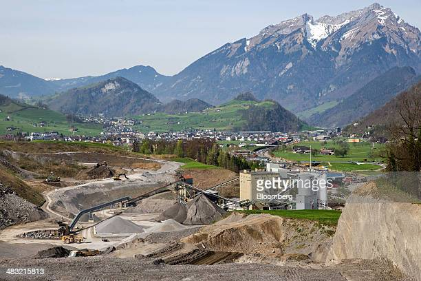 Mount Pilatus stands on the horizon beyond a stone quarry operated by Holcim Ltd in Oberdorf Switzerland on Monday April 7 2014 Holcim and Lafarge SA...