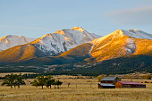 A snow capped Mount Princeton in the Collegiate Peak Range of the Rocky Mountains, overlooks an old ranch at morning's first light.  Late Fall has brought a dusting of snow to this 14,196 foot peak ne