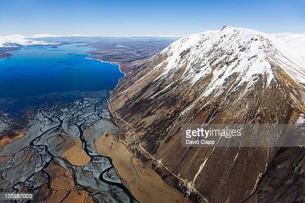 Mount Radove in Hall Mountain Range, bordering braided, glacial water of Godley River and Lake Tekapo, South Island, New Zealand