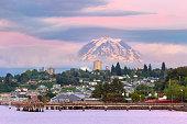 Mount Rainier over Tacoma Washington waterfront during alpenglow sunset evening