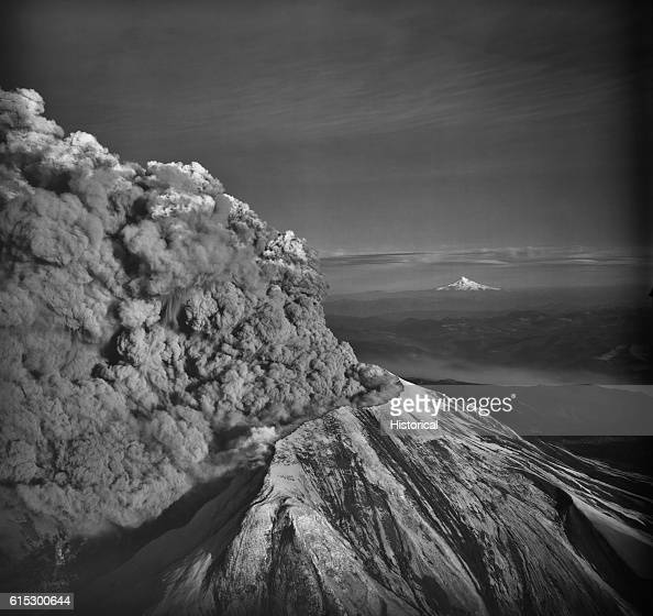 Mount Saint Helens in the southern Washington Cascades erupts violently on May 18 1980 This view from the west shows the huge column of ash which...