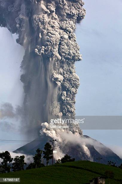 Mount Sinabung spews pyroclastic smoke as seen from Tigapancur village in Karo district on November 14 2013 in Medan Sumatra Indonesia Up to 4300...