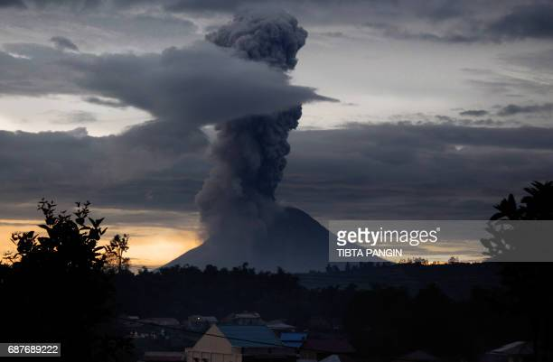 TOPSHOT Mount Sinabung volcano spews thick volcanic ash as seen from Brastagi in Karo North Sumatra province on May 24 2017 Sinabung roared back to...