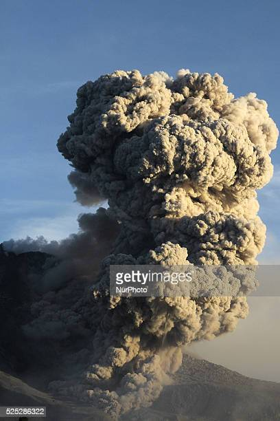 Mount Sinabung volcano with lava blowing a giant volcanic ash clouds that threatened villages during the eruption many times in the latest eruption...
