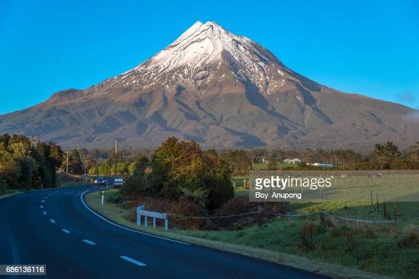 Mount Taranaki (2,518 metres) with the first snow of the year an iconic attraction place in Taranaki region of New Zealand.