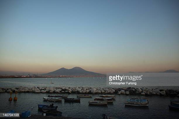Mount Vesuvius overlooks the Bay of Naples on November 17 2011 in Naples Italy Naples is famed for it's narrow streets pizza Mount Vesuvius and...