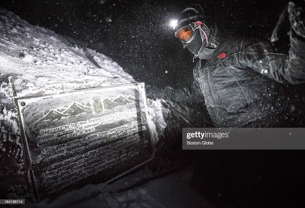 Mount Washington Observatory Winter EduTrip participant Mark Parsons reads a plaque dedicated to the New England Chapter of 10th Mountain Division...
