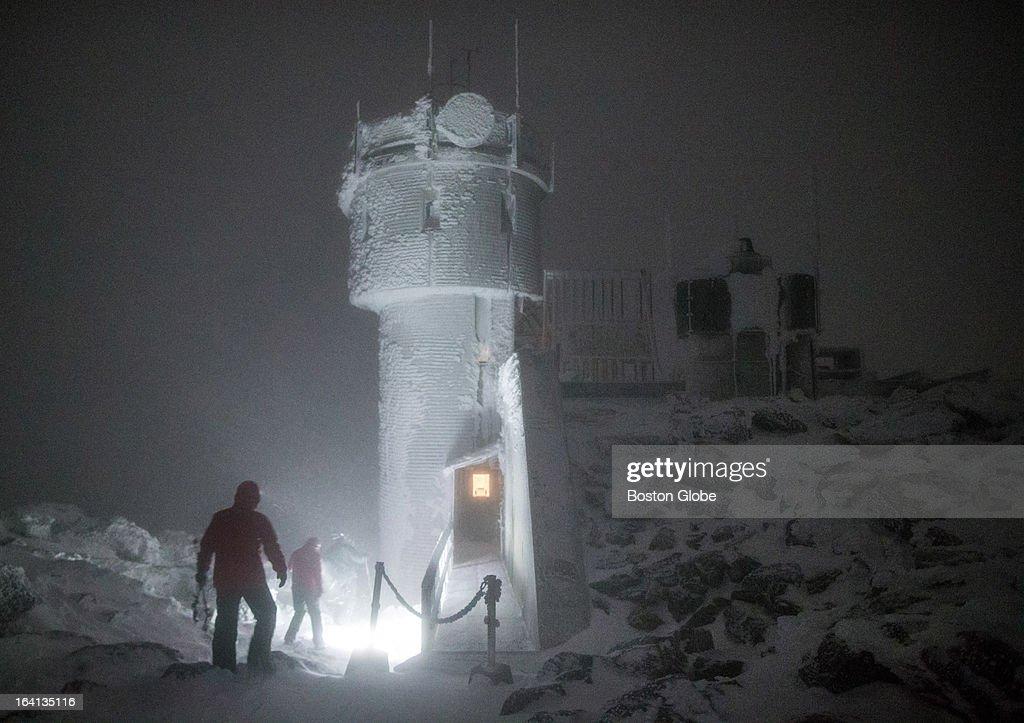 Mount Washington Observatory Winter EduTrip participants explore the summit of Mount Washington during the night of their visit