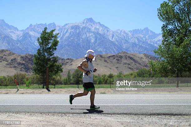 Mount Whitney is seen in the distance as David Ploskonka of Baltimore Maryland approaches the town of Lone Pine after completing more than 100 miles...