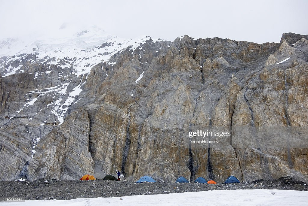 Mountain base camp of several tents : Stock Photo