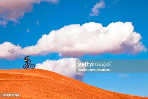 Mountain bike in Utah desert with clouds in background