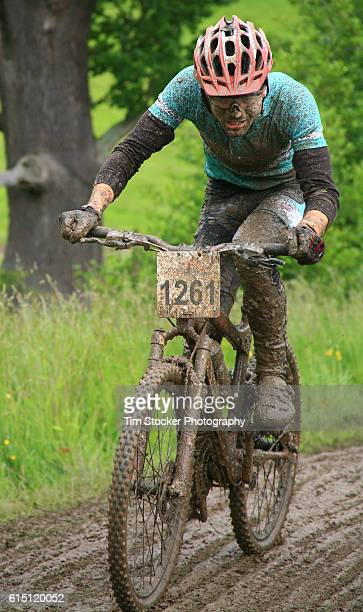 A mountain bike racer getting very muddy