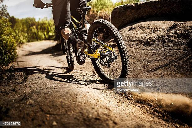 Mountain bike riding on dirt road showing it's tire tread