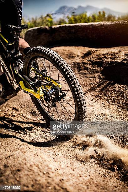 Mountain bike tire with good tread on a dirt path