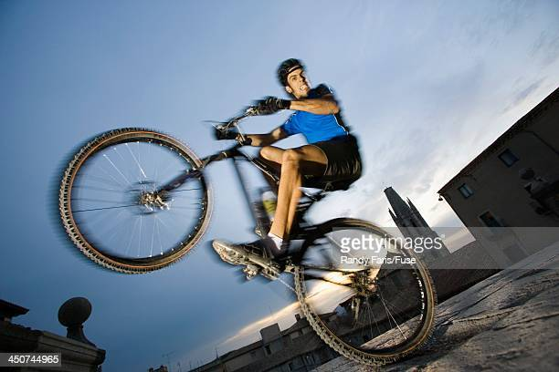 Mountain Biker Balancing on Rear Wheel