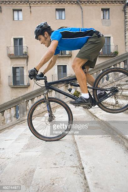 Mountain Biker Biking Down Stairs in Front of Cathedral