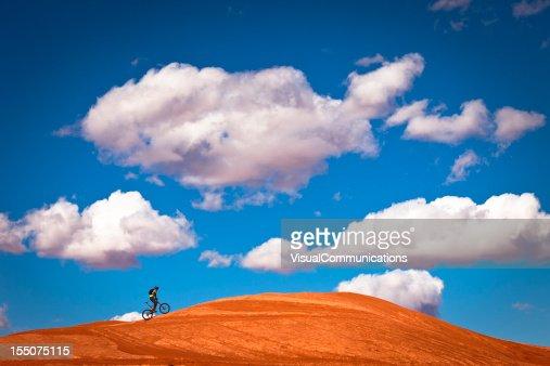 mountain biker climbing on slick rock.