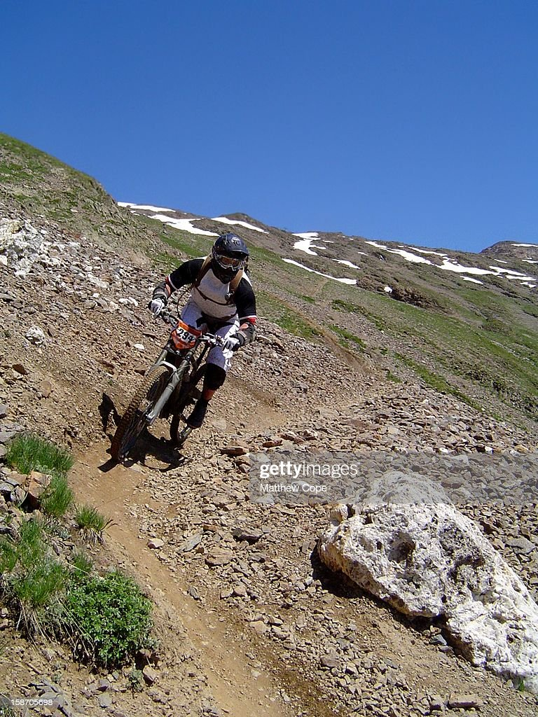 CONTENT] A mountain biker in full face helmet and goggles descending a dusty trail at the 2008 MegaAvalanche race in Alpe D'Huez, France.