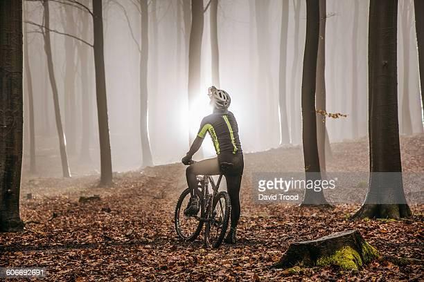 Mountain biker in misty forest